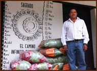 Photo of vendor standing in front of calendar painting.