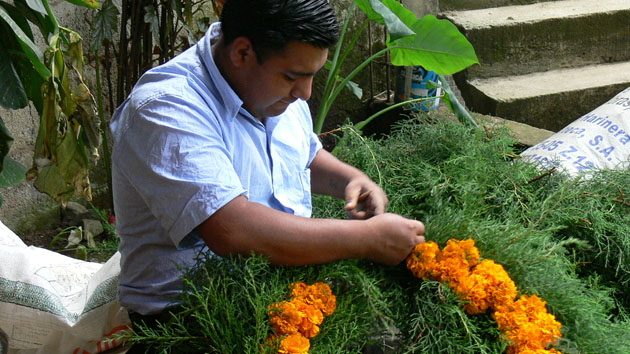 In the town of Santiago Sacatepéquez, Guatemala, men make wreaths of pine fronds and flowers to decorate family tombs for Day of the Dead. &nbsp;<span class='italic'>Photo Credit:&nbsp;Tepeu Roberto Poz Salanic</span>