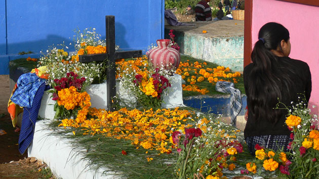 At the cemetery, family tombs are decorated with pine needles and flowers. During Day of the Dead, the ritual silence is followed by music and the laughter of children flying kites.&nbsp;<span class='italic'>Photo Credit:&nbsp;Tepeu Roberto Poz Salanic</span>