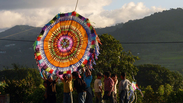 Hundreds of kites of all sizes fly throughout the day. The people of Santiago write messages to their ancestors on the tails of the kites. &nbsp;<span class='italic'>Photo Credit:&nbsp;Tepeu Roberto Poz Salanic</span>