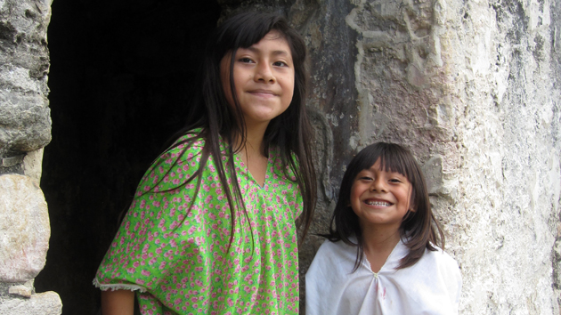Lacandon Maya families from nearby communities are the only ones allowed to drive visitors in and out of Bonampak. The Lacandon still use the site for ceremonies.  Linda Chanabor Chank'in and younger brother Akim from nearby Lacanjá Chansayab pose for a photograph.&nbsp;<span class='italic'>Photo Credit:&nbsp;Isabel Hawkins</span>