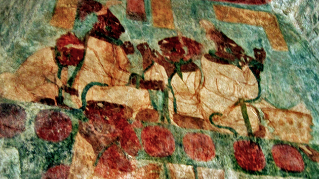 "Room 3. In an act of self-sacrifice through <a href='#' class='glossary-tip' title=""A ritualized act of self-sacrifice performed by the ancient Maya, done by the cutting or piercing of the body."">bloodletting</a>, women of the royal family give gratitude for Bonampak's success in battle. The ancient Maya used spines from <a href='#' class='glossary-tip' title=""A type of fish related to sharks. The ancient Maya used the spine of stingrays to perforate parts of their bodies in acts of bloodletting and self-sacrifice."">stingrays</a> and cacti, as well as <a href='#' class='glossary-tip' title=""A type of volcanic igneous rock, very strong and very sharp. The Maya used obsidian to make tools and weapons, and was used for ornamentation."">obsidian</a> knives, to pierce their ears, tongues, and genitals to spill their own blood for sacrifice. The woman on the upper right is probably Chan Muwan's wife, Lady Rabbit.&nbsp;<span class='italic'>Photo Credit:&nbsp;Isabel Hawkins</span>"