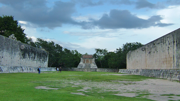 "The Great Ball Court is the largest in all of Mesoamerica. This ancient game is closely linked to the idea of ""sacred warfare."" As such, the game was not played for sport, but had deep ritual and <a href='#' class='glossary-tip' title=""Theory, model, or idea that seeks to understand the origin, structure, and evolution of the cosmos or universe."">cosmological</a> significance. The ball court was seen as a portal to the ""otherworld"" of the ancestors and of Maya deities. &nbsp;<span class='italic'>Photo Credit:&nbsp;Ideum/UC Regents</span>"