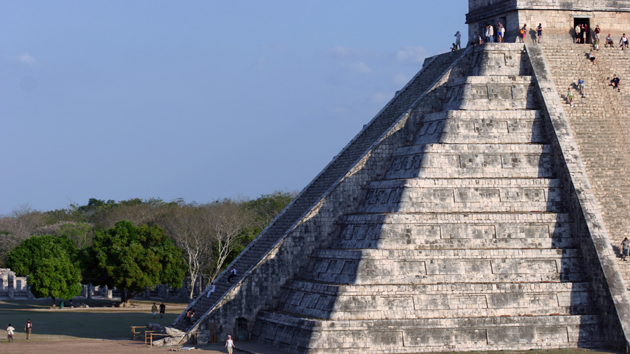 "A serpent of sunlight appears on the pyramid during the <a href='#' class='glossary-tip' title=""Equinox is the time of year when day and night are approximately 12 hours each, everywhere on Earth. It happens twice a year, on March 20th or 21st and September 22nd or 23rd."">equinoxes</a> each year. At sunset, the shadow of the pyramid's nine platforms outlines seven triangles of light on the <a href='#' class='glossary-tip' title=""Architectural feature running down the side of a staircase."">balustrade</a> of the north stairway. Together with the illuminated head of a serpent at the bottom of the stairway, create the effect of a slithering snake descending from the sky. The local Maya say that <a href='#' class='glossary-tip' title=""The feathered serpent of Maya mythology."">Kukulkán</a> symbolizes a cord that joins the Earth and the sky.&nbsp;<span class='italic'>Photo Credit:&nbsp;Ideum/UC Regents</span>"