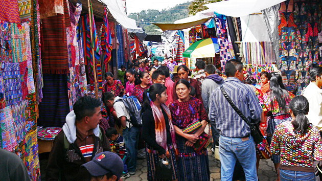 "Market day at Chichicastenango has been an ongoing tradition since ancient times. Vendors sell handicrafts, <a href='#' class='glossary-tip' title=""The traditional dress of Maya women. In the Yucatán the huipil is a dress, while in Chiapas and Guatemala, the huipil is worn as a blouse."">huipiles</a>, food, flowers, pottery, woodcarvings and traditional masks, condiments, medicinal plants, candles, <a href='#' class='glossary-tip' title=""A type of tree resin used by the Maya as incense."">copal</a>, <a href='#' class='glossary-tip' title=""Limestone, or lime, is a general term for calcium-containing inorganic materials. The Maya use lime to cook corn and to make stucco, a type of plaster used to cover the stone structures and interiors of ancient buildings."">limestone</a> for preparing tortillas, <a href='#' class='glossary-tip' title=""A stone mortar with two elements, a rectangular base and a stone cylinder known as ""mano,"" which is pressed against the base to grind food, especially grains and seeds."">metates</a>, farm animals, <a href='#' class='glossary-tip' title=""A machete is a large cutting tool similar to a short sword. About 2 feet in length, it has a single sharp edge and it is used to cut grass and other plants."">machetes</a> and other tools, including CDs and electronic supplies, along with all things imaginable.&nbsp;<span class='italic'>Photo Credit:&nbsp;Tepeu Roberto Poz Salanic</span>"