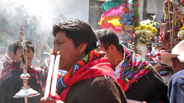 "<a href='#' class='glossary-tip' title=""Confraternities or honorary councils of Maya religious leaders common in Chiapas and Guatemala. Cofradías interpret Catholic ritual and symbolism using Maya beliefs and worldview."">Cofradía</a> leaders, clad in traditional dress, carry incense, candles, and a ceremonial staff topped with a silver badge, a symbol of the Sun and their patron saint. To be a Cofradía member demands great responsibility, effort, and personal expense. &nbsp;<span class='italic'>Photo Credit:&nbsp;Isabel Hawkins</span>"