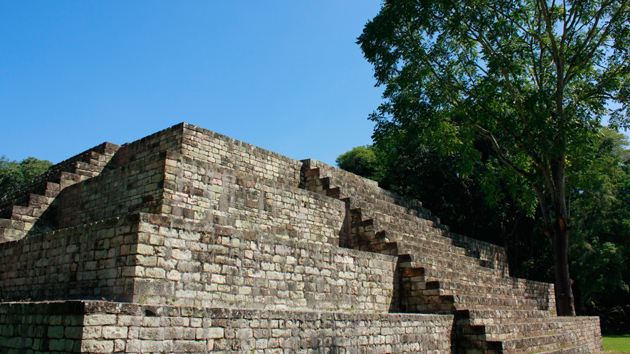 "This stepped pyramid is located on the Sun Court of the Great Plaza.  Research by Honduran scholars has found that the monuments in the Sun Court were designed by the ancient Maya to facilitate solar observations throughout the year.  This pyramid was used to facilitate observations of <a href='#' class='glossary-tip' title=""The winter solstice is when we experience the longest night and the shortest day of the year. The summer solstice is when we have the longest day and shortest night of the year."">solstices</a>, <a href='#' class='glossary-tip' title=""Equinox is the time of year when day and night are approximately 12 hours each, everywhere on Earth. It happens twice a year, on March 20th or 21st and September 22nd or 23rd."">equinoxes</a>, and <a href='#' class='glossary-tip' title=""In tropical latitudes, the moment when the Sun, in its apparent motion caused by the rotation of the Earth, passes through a point directly above the observer twice a year."">zenith passages</a> of the Sun.&nbsp;<span class='italic'>Photo Credit:&nbsp;Tepeu Roberto Poz Salanic</span>"