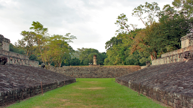 Ball Court A, one of three courts at the site, is the second largest in Mesoamerica behind the Great Ball Court at Chichén Itzá.  The ballgame was played using a heavy, solid rubber ball. The players would hit it with hips and thighs covered by protective gear. The Mesoamerican ballgame had cosmic meaning for the ancient Maya, with the ball symbolizing a celestial object and the court itself serving as a portal to the world of the ancestors and deities.&nbsp;<span class='italic'>Photo Credit:&nbsp;Julián Cruz Cortés</span>