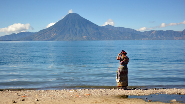 A Maya woman on the shores of Lake Atitlán. The lake is formed from the caldera that resulted from the powerful Los Chocoyos eruption that occurred some 85,000 years ago.&nbsp;<span class='italic'>Photo Credit:&nbsp;Istock: Paco Romero</span>