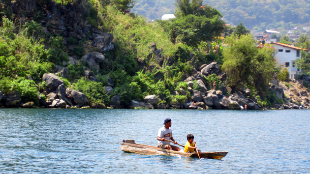 Rowing on the lake is a necessity. The Maya who live on the shores of Lake Atitlán are very conscious and respectful of the unpredictable power of the lake, which can be dangerous.  &nbsp;<span class='italic'>Photo Credit:&nbsp;Isabel Hawkins</span>