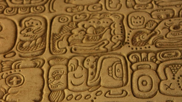"Detail of the ""Tablet of the 96 Hieroglyphs,"" dating from 783 CE. This tablet is the finest example of calligraphic style <a href='#' class='glossary-tip' title=""The basic unit of the writing system of the ancient Maya."">hieroglyphs</a> known in the Maya world. The panel was found in the Palace and narrates a succession of rulers from K'inich J'anab Pakal I to Kuk B'alam II.&nbsp;<span class='italic'>Photo Credit:&nbsp;Julián Cruz Cortés</span>"