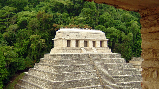 "The Temple of the Inscriptions was built during the reigns of K'inich Ja'nab Pakal I and his son K'inich Kan B'alam (603-702 CE). This temple houses the longest legible Maya <a href='#' class='glossary-tip' title=""The script or writing system of the ancient Maya of Mesoamerica, found inscribed in stone, pottery, bone, jade, accordion folded books, stucco, and other surfaces."">hieroglyphic</a> text in existence. Deep within the pyramid, the tomb and sarcophagus of K'inich Ja'nab Pakal I was found in 1952 by Mexican archaeologist Alberto Ruz Lhuillier. &nbsp;<span class='italic'>Photo Credit:&nbsp;Isabel Hawkins</span>"