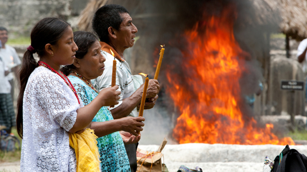 "Maya families participating in a ceremony for the <a href='#' class='glossary-tip' title=""The winter solstice is when we experience the longest night and the shortest day of the year."">winter solstice</a> at Tik'al.&nbsp;<span class='italic'>Photo Credit:&nbsp;Istock: Micky Wiswedel</span>"