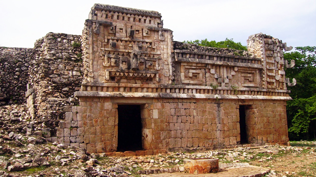 "Palace structure at the Xlapac Archaeological Site in the <a href='#' class='glossary-tip' title=""Meaning ""mountain"" in Yucatec Mayan, Puuc is a region in the northwest of the Yucatán Peninsula. It is also a style of architecture characterized by skilled ornamentation."">Puuc</a> region. Xlapac means ""Old Walls"" in <a href='#' class='glossary-tip' title=""One of several Mayan languages, spoken in the Yucatán peninsula and parts of Chiapas and Guatemala."">Yucatec Mayan</a>. This building shows the mosaic style of Maya architecture with stones fitting seamlessly together.&nbsp;<span class='italic'>Photo Credit:&nbsp;Isabel Hawkins</span>"